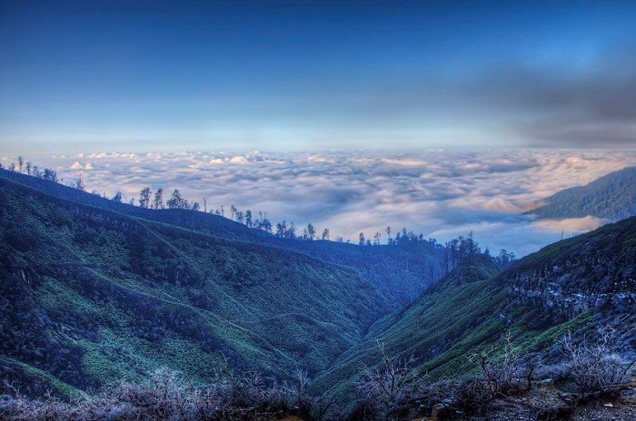 The view at dawn from above the clouds at Ijen Crater in Java. Photo by Jimmy McIntyre, Flickr