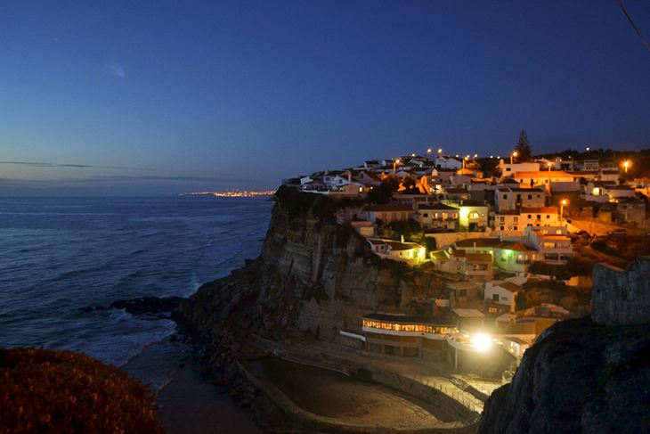 Azenhas do Mar with its white washed walls is tucked away perfectly on the cliffside. Photo via Amazing Places on Earth