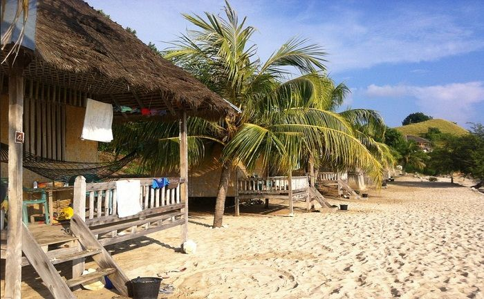 Bunglows on the beach can be hired cheap on Seraya Island. Photo by Stuart McDonald, flickr