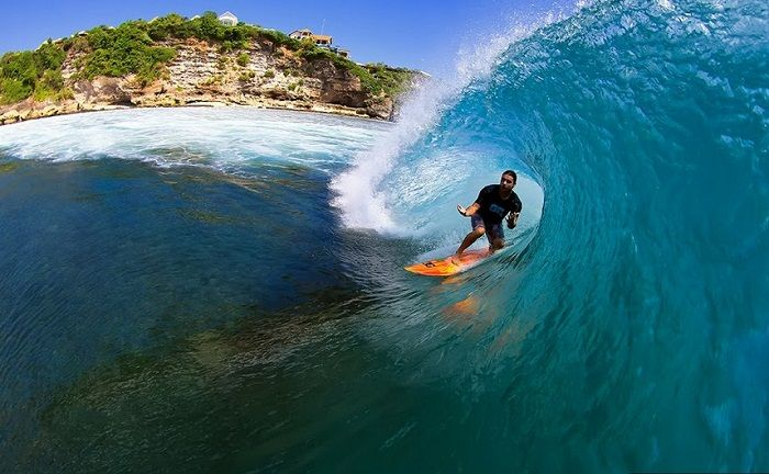 Surfer rides a barrel in Bali. Photo by Trevor Murphy
