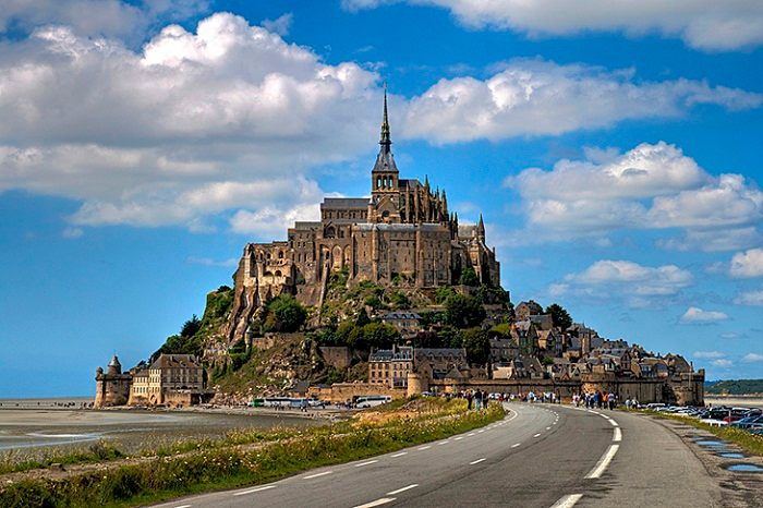 The Mont Saint Michel sits on an island north of France inhabiting 44 people. Photo by Matthieu Luna, flickr