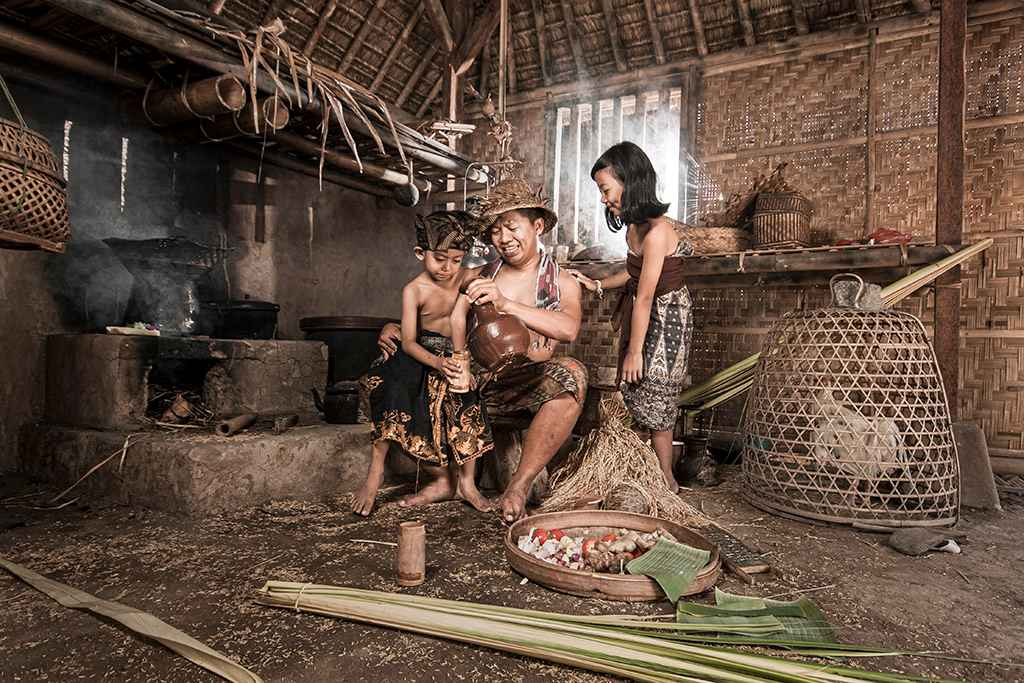 A family gathers in their hut in Indonesia. Photo by Pandu Adnvana, FlickrA family gathers in their hut in Indonesia. Photo by Pandu Adnvana, Flickr