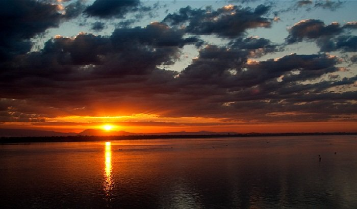 A sensational sunset shot over the Mekong River from Pakse, Photo by Andreas Metz, Flickr
