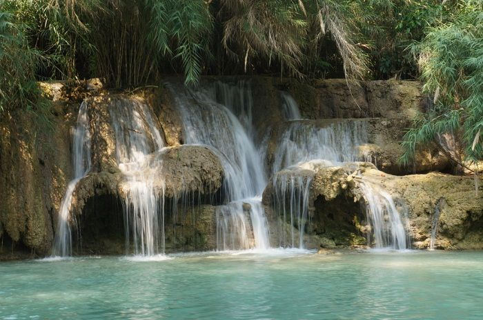 The beautiful Kuang Si waterfall is well worth a day trip from Luang Prabang. Photo by lifechangingyear.com
