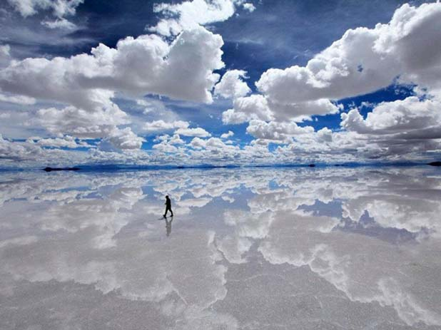 Thin layer of water forms on Salar de Uyuni during winter. Image via Distractify.