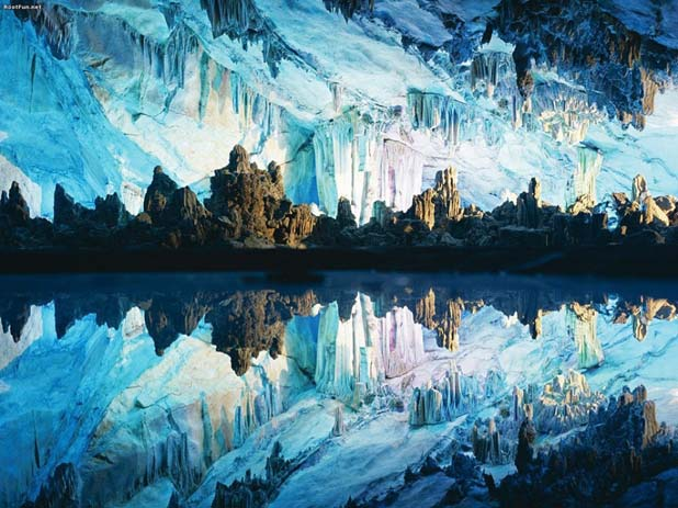 China's Reed Flute Caves were created by water erosion. Image via Distractify.