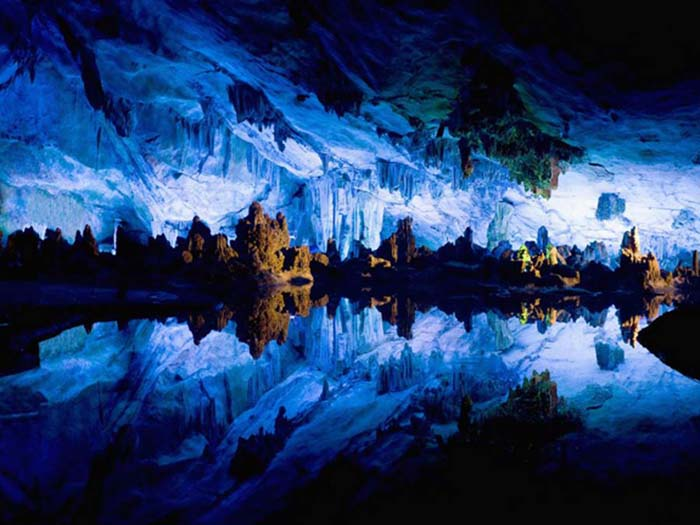 The Reed Flute Cave has multi-coloured lighting installed by the Chinese Government. Photo by Jarno Gonzale