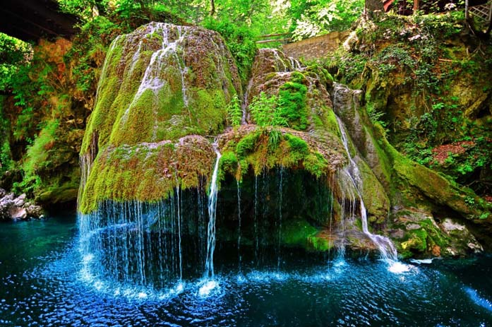 Bigar Waterfall is has an enchanting effect. Image via Distractify.