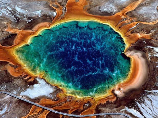 These hot springs credits its vivid colours to microbes. Image via Distractify.