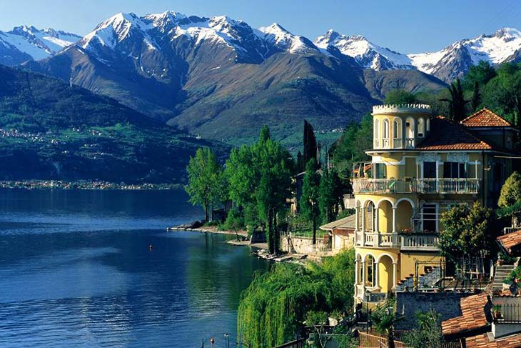 The beautiful buildings that line the side of Lake Como. Photo via thetimes