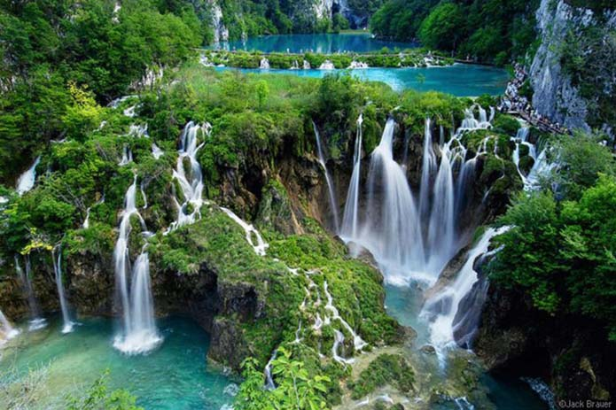 This lake is naturally created as water flowed around limestone. Image via Distractify.