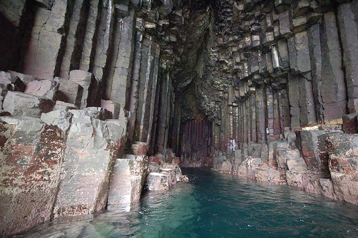 The rushing water inside Fingals Cave create eerie sounds. Photo by whenonearth.net