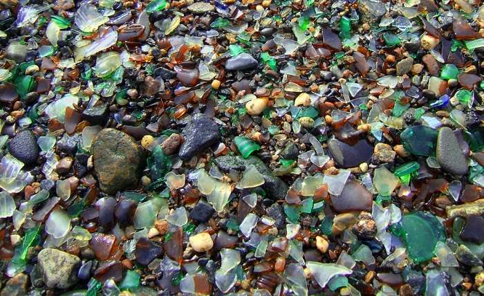 Incredible glass beach destroyed by humans, but reformed by nature. Photo by Astoria4u