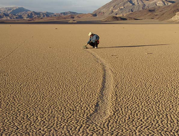 Scientist conducting field research on moving rocks in Death Valley. Photo via Ground Truth Investigations