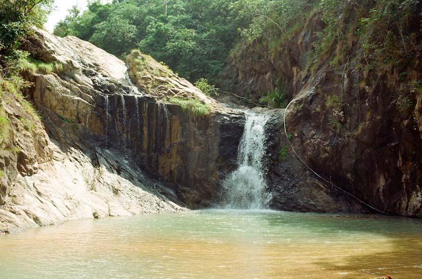 Than Sadet waterfall flows all year round, but gushes during the wet season. Photo via Katya Stavitskaya