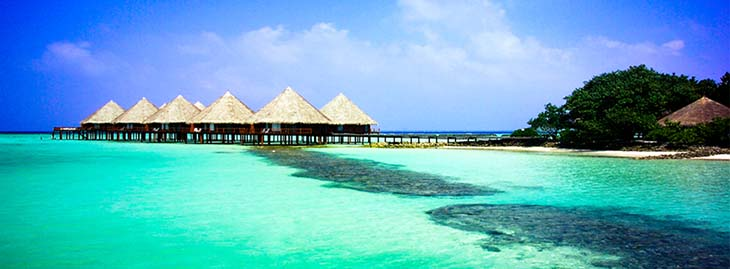 The Water bungalows of Velidhu Island Resort in the Maldives. Photo via velidhu