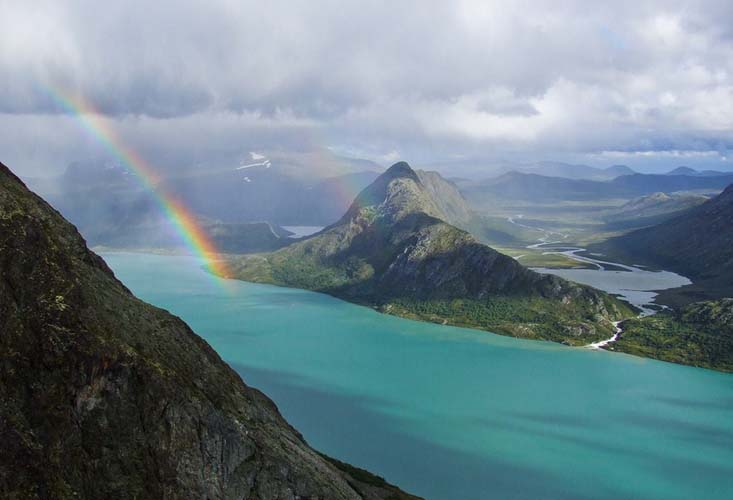 A rainbow arcs over Gjende Lake. Photo by Steffen Sauder