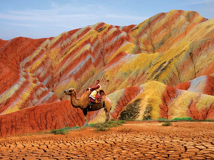 The incredible Zhangye Danxia Landform is a must see. Photo via wordsofpictures